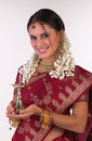 Indian girl with sari holding the lamp Stock Photos