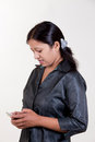 Indian girl texting over mobile Royalty Free Stock Photo