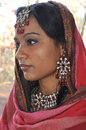 Indian girls profile a beautiful young woman is looking down with a sad expression Royalty Free Stock Photo