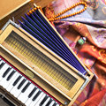 Indian harmonium, a traditional wooden keyboard instrument, close-up Royalty Free Stock Photo