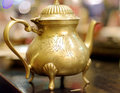Indian kind hot tea drinks beautiful brass craft work Royalty Free Stock Image