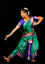 Indian lady performing a bharatanatyam dance young woman in traditional sari dancing classical on black background Royalty Free Stock Images