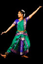Indian lady performing a bharatanatyam dance young woman in traditional sari dancing classical isolated on black background Stock Photography