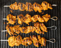 Indian lamb tikka kebabs cooking on hot griddle plate Stock Photography