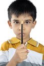 Indian little boy holding the pencil Royalty Free Stock Photo