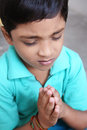 Indian Little Boy Praying Stock Image
