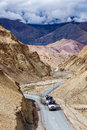 Indian lorry trucks on highway in Himalayas. Ladakh, India Royalty Free Stock Photo