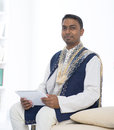 Indian male with tradtional dresss and tablet computer Stock Photography