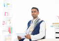 Indian male with tradtional dresss and tablet computer Stock Photos