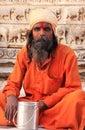 Indian man sitting at Jagdish temple, Udaipur, India