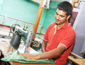 Indian man tailor portrait of at work place with sewing machine Stock Images