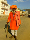 Indian man walking in the street of pushkar india rajasthan Royalty Free Stock Photography