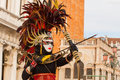 Indian masked girl in venice with her bow and arrows Royalty Free Stock Photo