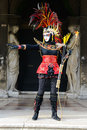 Indian masked girl in venice with her bow and arrows Royalty Free Stock Images