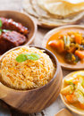 Indian meal biryani rice chicken curry acar vegetable roti chapatti and papadom Stock Photo