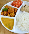 Indian meal consisting of roti rice dal and cauliflower curry Stock Images