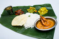 Indian meal with curry shrimp and plain rice on banana leaf tray Royalty Free Stock Photo