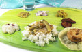 Indian meals south on a green banana leaf Royalty Free Stock Photos
