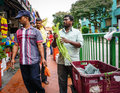 Indian men selling fruits in Chinatown, Singapore