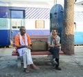 Indian men waiting at the train station in Varanasi, India Royalty Free Stock Photo