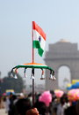 Indian national flag mini against backdrop of india gate new delhi india Stock Image