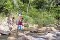 Indian native guides crossing river with traditional backpacks two local the venezuelan for carrying goods on the way to kukenan Royalty Free Stock Photo