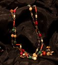 Indian necklace with nine stones in black background Stock Photography