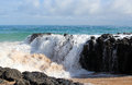 Indian ocean waves dumping against dark basalt rocks on ocean beach bunbury western australia the mighty in herald an approaching Stock Photos