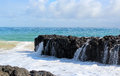 Indian ocean waves dumping against dark basalt rocks on ocean beach bunbury western australia the mighty in herald an approaching Royalty Free Stock Image