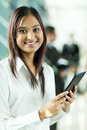 Indian office worker attractive holding tablet computer in Royalty Free Stock Image