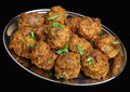 Indian onion bhajis on stainless steel platter Stock Photo