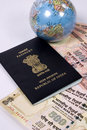 Indian passport with travel money Royalty Free Stock Photos