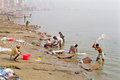 Indian people doing laundry on the shore of the ganges river varanasi india Stock Images
