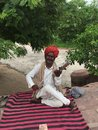 An Indian people play traditional instrument