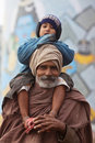 Indian pilgrim and his son Stock Photo