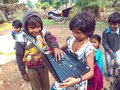 indian poor girl giving training about laptop computer system at village area open class in india January 2020 Royalty Free Stock Photo
