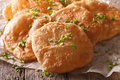 Indian puri bread macro on the table. Horizontal Royalty Free Stock Photo