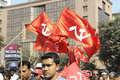 Indian rally kolkata february marchers hoist the communist flags in front of the tata center in kolkata during a political in Royalty Free Stock Photos