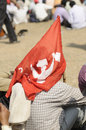 Indian rally kolkata february an unidentified man covers himself up with the communist flag to escape the heat during a political Stock Photos