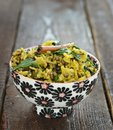 Indian rice khichdi to bowl Stock Image