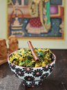 Indian rice khichdi to bowl Stock Photo