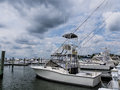 Indian river inlet marina boats moored at under cloudy sky Royalty Free Stock Images