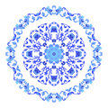 Indian round ornament, kaleidoscopic floral pattern, mandala. Design made in Russian gzhel style and colors.