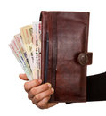 Indian rupees holding and giving to someone from purse and passport inside Royalty Free Stock Photo