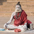 Indian sadhu holy man varanasi uttar pradesh india december an unidentified sits on the ghat along the ganges on december in Stock Photos