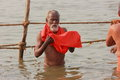 Indian sadhu taking holy dip in river Ganga Stock Photos