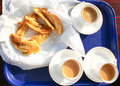 Indian snacks with cups of tea. Royalty Free Stock Photography