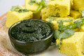 Indian Snacks Dhokla with green chutney Stock Image