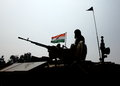 Indian soldier and indian national flag silhouette of main battle tank during the th january pared is on background Royalty Free Stock Photos