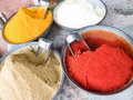 Indian spices four bowls of on a market including turmeric cumin and hot chili powder Royalty Free Stock Photo